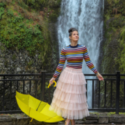 Angela at Multnomah Falls holding yellow umbrella